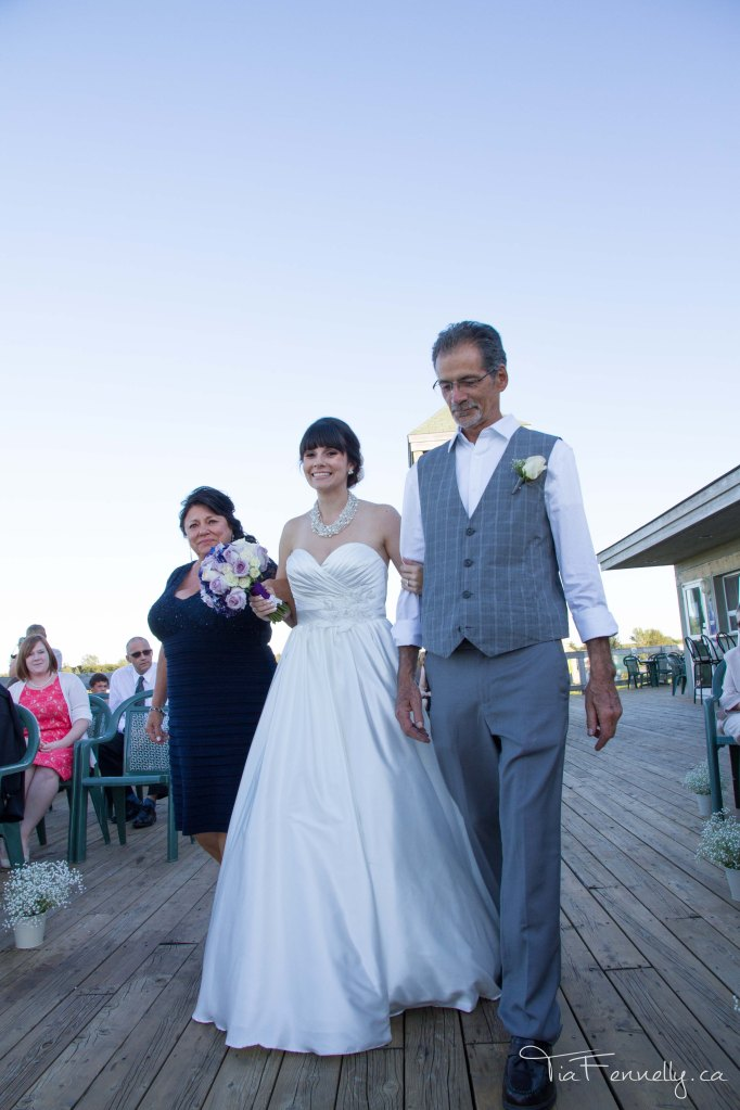 Walking down the aisle with my wonderful parents